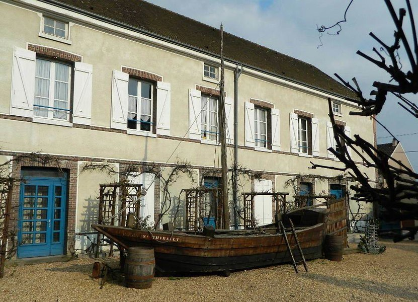 Boat in courtyard of Dreux Wine-growers and Craftsmen Ecomuseum, Eure-et-Loir (France).