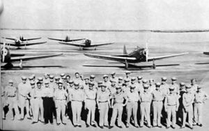 United States Army Air Forces Contract Flying School Airfields - Arledge Field, Texas, 1943.  Flight Instructors from the Lou Foote Flying Service stand in front of their Fairchild PT-19 Trainers
