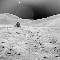 A lunar landscape with a lander in the background