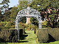 Feeringbury Manor garden path gazebo, Feering Essex England.jpg