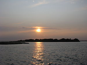 Sunset over the Fire Island Inlet, south of Lo...