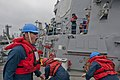 Flickr - Official U.S. Navy Imagery - Sailor directs line handlers at sea..jpg