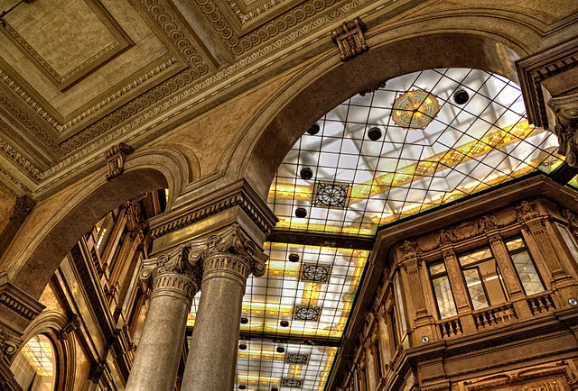 2nd place: Galleria Alberto Sordi shopping arcade in Rome: main entrance, arches and stained glasses