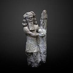 Foundation figurine of a genie holding a lamp-N 8282
