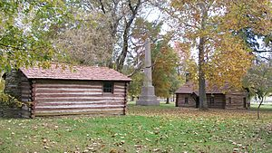 Gnadenhutten massacre - The village with the Village Cooper operating in the building to the left, the monument center, and cabin on the right.