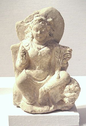 Nana (Kushan goddess) - Goddess Nana, seated on a lion, Afghanistan, 5-6th century.