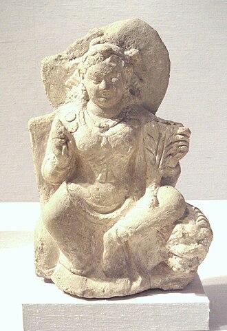 Nana (Kushan goddess) - Goddess Nana, seated on a lion, Afghanistan, 5-6th century.