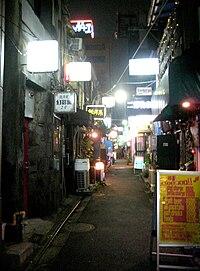 Dark top white bottom in alley