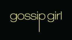 "The words ""gossip girl"" written in yellow on a black background. The letters are lowercase and the letter ""P"" has an elongated tail"