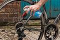 Greasing bicycle chain.jpg