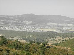 Guelma Valley as seen from Ben Djerrah, partially showing the metropolitan area of Guelma with the cities of Boumahra Ahmed, Belkheir, and Guelma visible (from right to left/east to west)