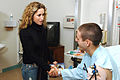 Heidi Newfield with soldier in hospital.jpg
