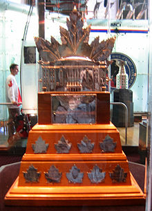 Silver replica of Maple Leaf Gardens mounted on a wooden base