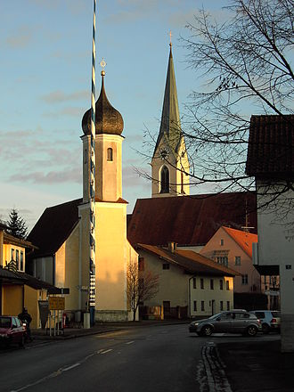 Hohenlinden - View of the main street, in the foreground the old church, in the background the new