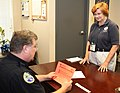 Hurricane-Tropical Storm - Long Beach, Miss. , Sep. 20, 2012 -- FEMA Community Relations Specialist Barbara Bass asks Long Beach Assistant Police Chief Alan Bond to encourage Hurric - DPLA - 939959981f6e5b35b164892c59b40a34.jpg