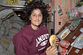 ISS-32 Sunita Williams prepares to eat a snack.jpg