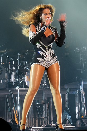 "Beyoncé - Beyoncé performing ""Single Ladies (Put a Ring on It)"" during the I Am... World Tour. The song reached number one on the Billboard Hot 100, earned the Grammy Award for Song of the Year and spawned the Internet's first major dance craze."