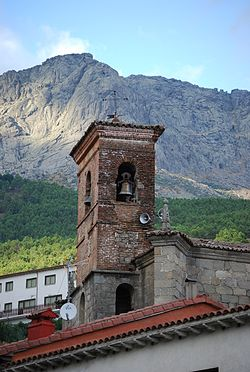 Tower of the church of Cuevas del Valle,in the background the Sierra de Gredos