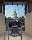 Liberty Bell with Independence Hall beyond window across Chestnut St.