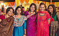 Indian women are celebrating the wedding ceremony (8916775514).jpg