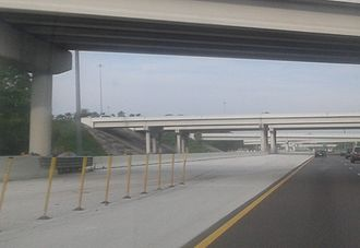 Contraflow lane reversal - Modular Jersey barriers are semi-permanently installed as a median barrier between the left and second-from-left bridges, along Interstate 4 near Tampa. They can be quickly removed to allow some eastbound traffic to transfer to the westbound lanes when contraflow is enacted.