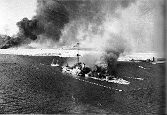 Italian cruiser San Giorgio - San Giorgio burning after being scuttled at Tobruk, 22 January 1941