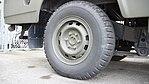 JGSDF Power Supply Vehicle(Nissan Safari, 04-1569) rear wheel(right) at Camp Akeno November 4, 2017.jpg