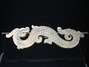 Warring States period - A carved-jade dragon garment ornament from the Warring States period