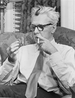James Thurber lighting a cigarette