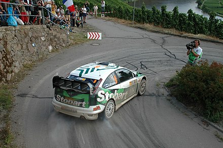 A cameraman at a hairpin turn at the 2007 Rallye Deutschland. Jari-Matti Latvala - 2007 Rallye Deutschland.jpg