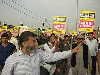 Greece–Pakistan relations - Javied Aslam Arain, President of the Pakistani Community of Greece, staging a protest with Pakistani migrants.