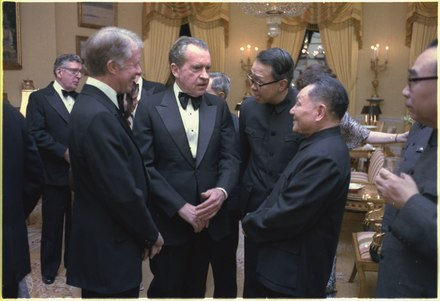 Nixon speaking with Chinese Vice Premier Deng Xiaoping and U.S. President Jimmy Carter at the White House, 1979 Jimmy Carter, Richard Nixon and Deng Xiaoping during the state dinner for the Vice Premier of China. - NARA - 183214.tif