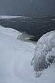 Kallon rantaa lumisateessa.JPG