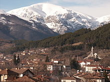 The town of Kalofer with a snowy mountain in background.