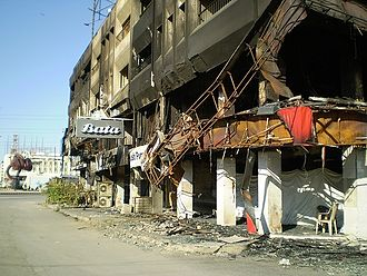 Assassination of Benazir Bhutto - Burned buildings with broken windows in Karachi, following rioting