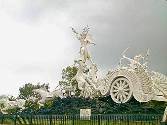 Ghatotkacha - Ghatotkacha standing on horses in a fight with Karna, an artwork in Bali Indonesia