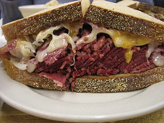 Reuben sandwich hot sandwich of corned beef, Swiss cheese, with Russian or Thousand Island dressing, and sauerkraut