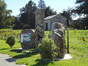 Kelso, New Zealand - The Kelso Monument, showing flood levels; an old railway shed in the background