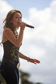 Kira Isabella performing at the Boots and Hearts Music Festival 2013