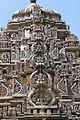 Kirtimukha sculptures on shikhara (tower) of Amrutesvara temple at Amruthapura.jpg