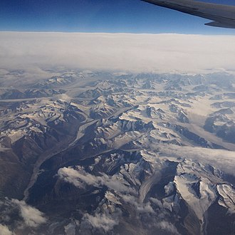 Kluane National Park and Reserve - An aerial shot of Kluane National Park's glaciers, icefields, and small mountains.