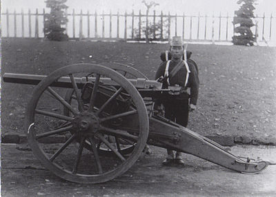 Japanese artillery unit, at the Koishikawa arsenal, Tokyo, in 1882. Photographed by Hugues Krafft. KoishikawaArtillery1882.jpg