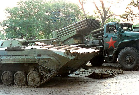 Decommissioned UNITA BMP-1 and BM-21 Grads at an assembly point. Krichsmaterial.jpg