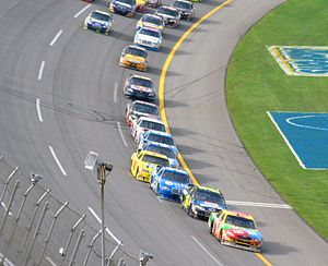 Drafting (aerodynamics) - A line of cars at Talladega Superspeedway utilizing the slipstream of leader Kyle Busch.