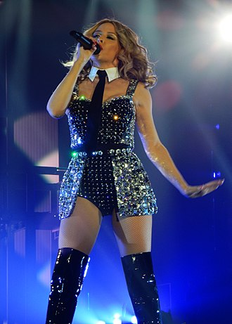 """On a Night Like This - Minogue singing """"On a Night Like This"""" during her Kiss Me Once Tour, on 2014."""