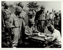 Lt. Col. Sylvester Del Corso, commander of the 1st Battalion, 145th Infantry, receives the surrender of Japanese forces on the Philippine Island of Luzon