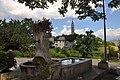 La Bréole Lavoir-fontaine et village.jpg