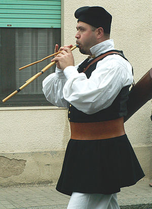 Launeddas - A Sardinian man in traditional clothing playing the launeddas