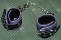 Leather cuffs purple.png