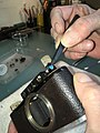Leica II D aka Couplex rangefinder miror replacement (32785250594).jpg